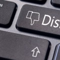 A dislike message on enter keyboard for social media concepts.